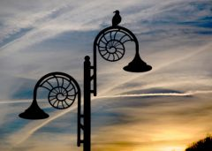 Ammonite lamp post at dusk, Lyme Regis - © MichaelMaggs - License CC-BY-SA 3.0